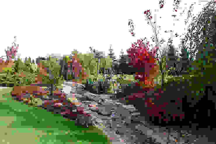 Jardines de estilo  por Centrum ogrodnicze Ogrody ResGal