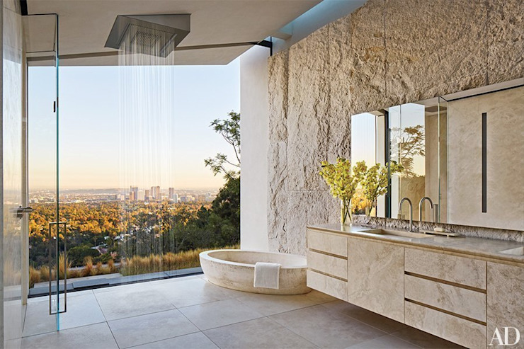 Travertine bath in Michael Bay home in Los Angeles Pietre di Rapolano BathroomBathtubs & showers Marble Beige