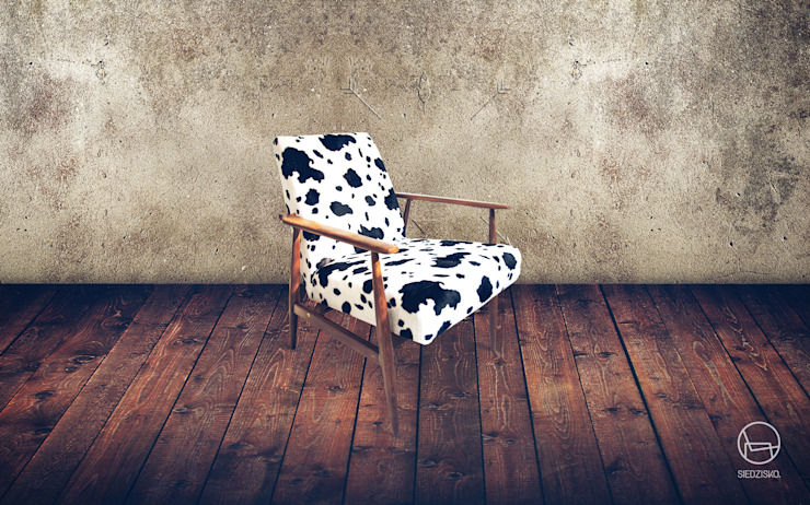 Aniamalista armchair from 60s par homify Rural