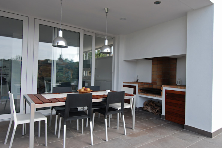 Terrace with fireplace Modern Terrace by FG ARQUITECTES Modern