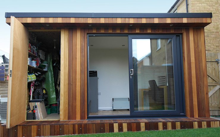 Garden Office with hidden storage shed built by Garden Fortress , Surrey by Garden Fortress Modern