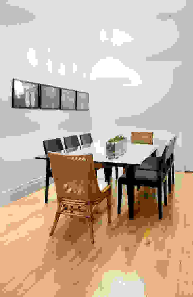 Apartamento Madeira Salas de jantar modernas por Coutinho+Vilela Moderno