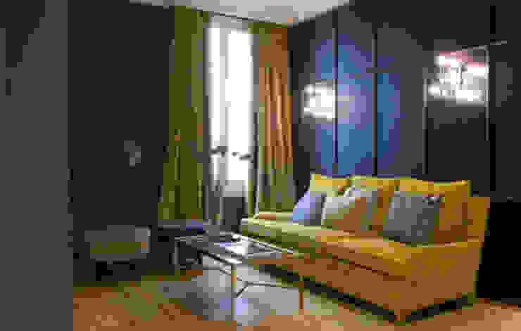 Sala de estar para showroom Grupo Lamadrid Salones de estilo ecléctico de DyD Interiorismo - Chelo Alcañíz Ecléctico