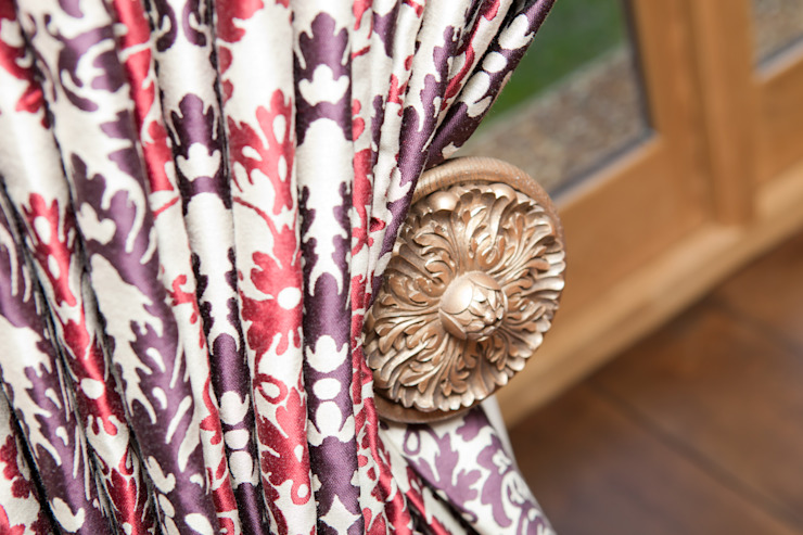 Ornate tie back and rich curtain fabric by Design by Deborah Ltd