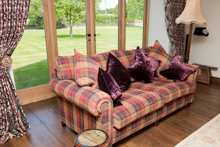 Check sofa and velvet cushions: country  by Design by Deborah Ltd, Country