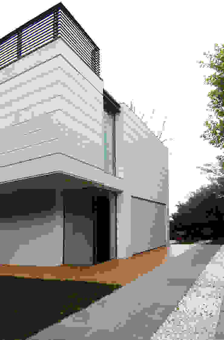 Modern garage/shed by NAT OFFICE - christian gasparini architect Modern