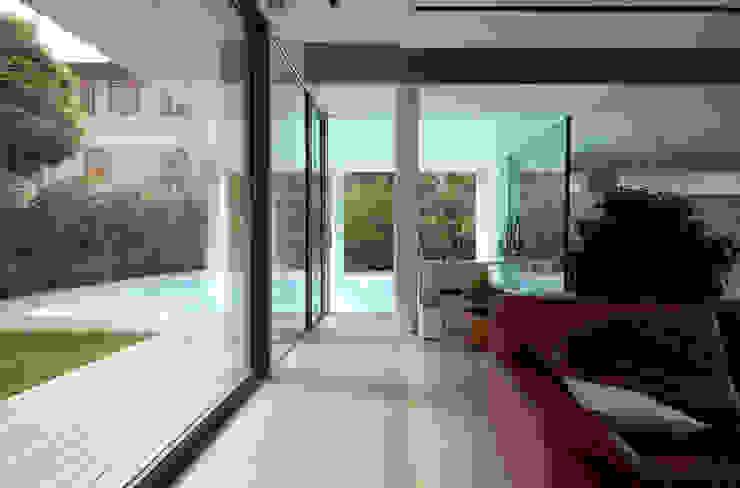 Modern living room by NAT OFFICE - christian gasparini architect Modern