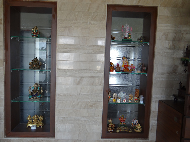 niches in the pooja room to display the Ganesha collection of the client Modern walls & floors by Hasta architects Modern