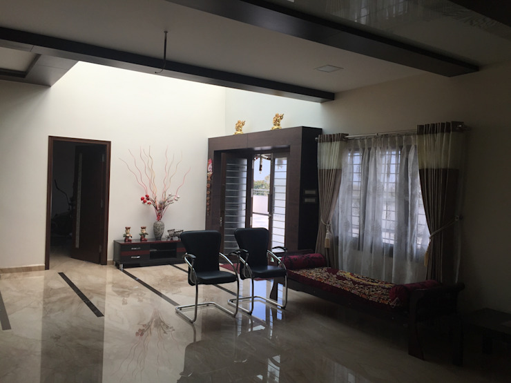 Residence of Mr. Vijayanand Modern living room by Hasta architects Modern