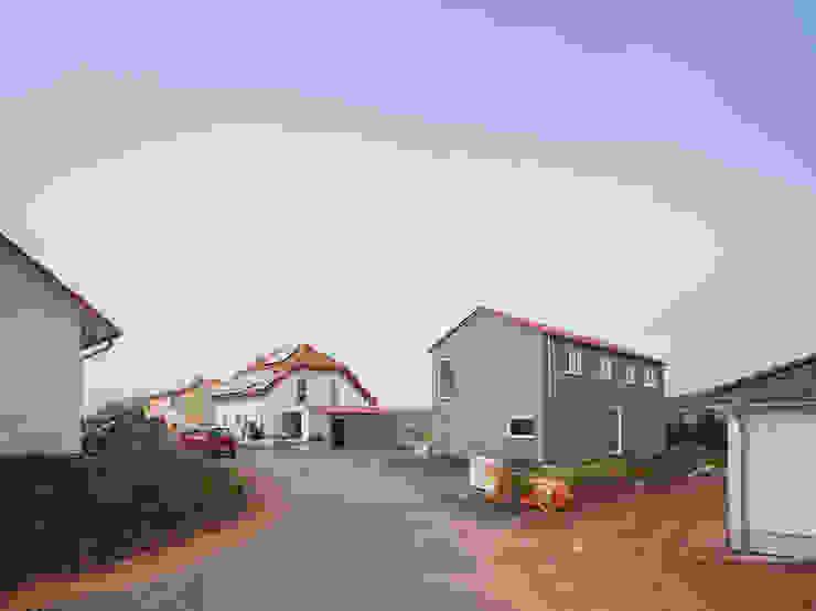 Дома в стиле модерн от Bau Eins Architekten BDA Модерн