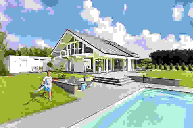 Дома в стиле модерн от DAVINCI HAUS GmbH & Co. KG Модерн