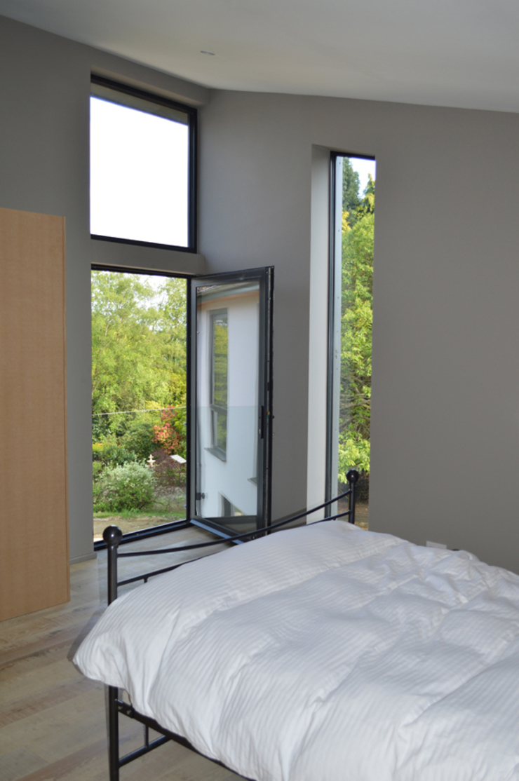 The Master Bedroom features a Juliet balcony Modern balcony, veranda & terrace by ArchitectureLIVE Modern