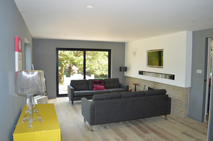 New patio doors in the Living Room look out to the Southerly Garden Modern living room by ArchitectureLIVE Modern