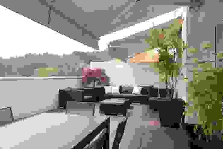 terrazzo Balcone, Veranda & Terrazza in stile moderno di Gaia Brunello | in-photo Moderno