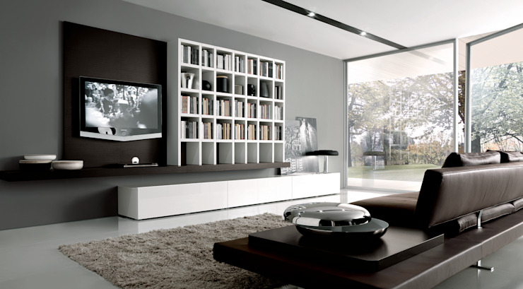 Wall hung TV unit and bookcase. Also with hidden floor storage.: modern  by Lamco Design LTD, Modern