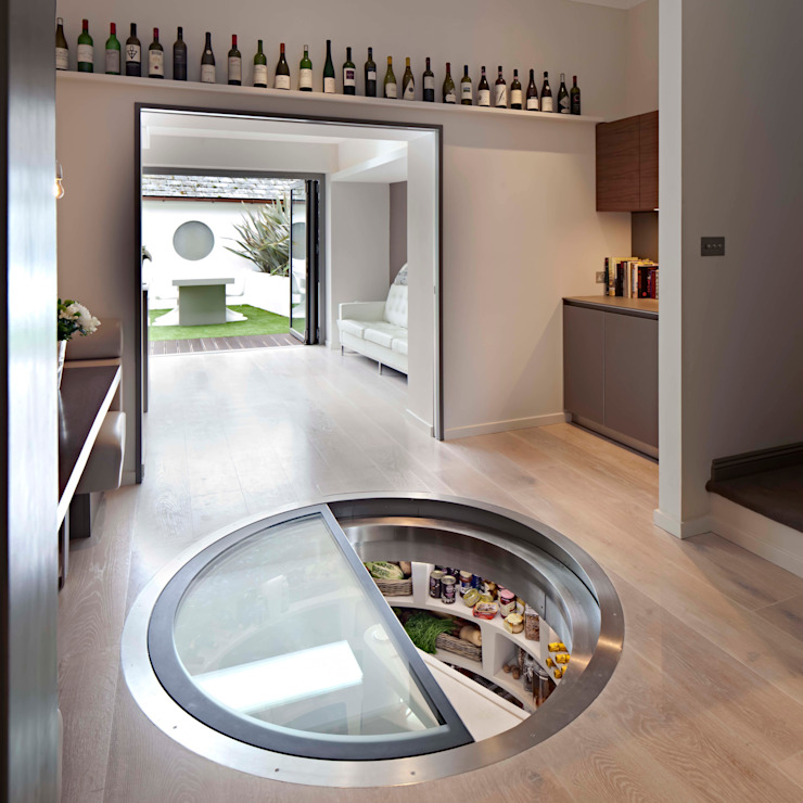 White Spiral Cellar with retractable Door Bodegas de estilo moderno de homify Moderno