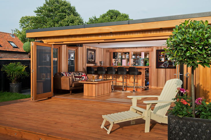 Bespoke garden cinema room with a bar Crown Pavilions Modern Garage and Shed