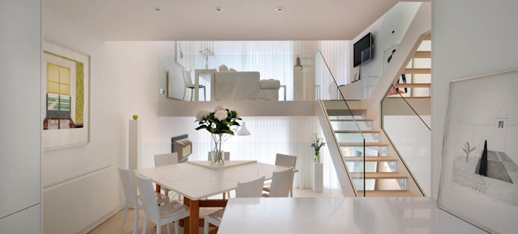 Central staircase Modern corridor, hallway & stairs by TG Studio Modern