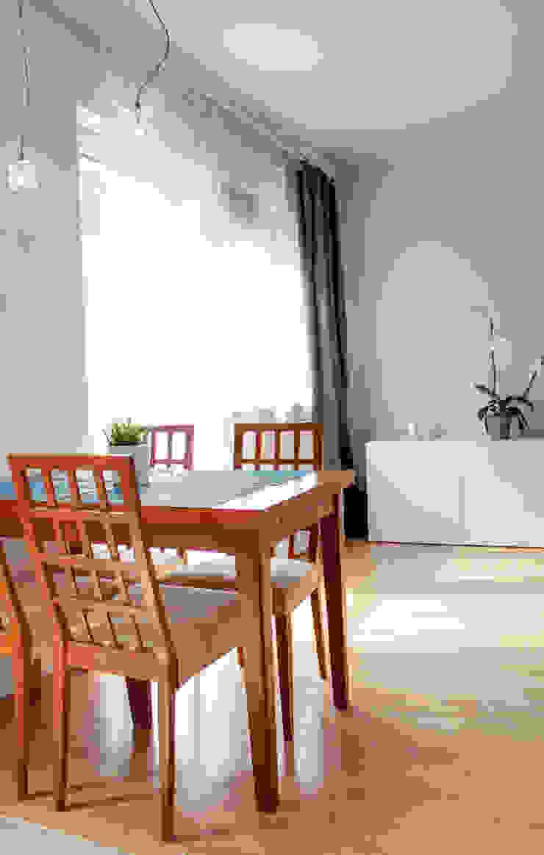 Mieszkanie po Home staging'u Nowoczesna jadalnia od Studio projektowe SUZUME Nowoczesny
