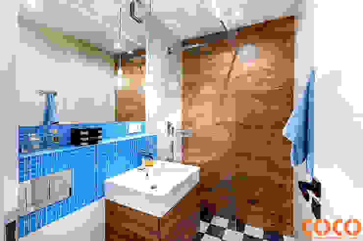 Banheiros modernos por COCO Pracownia projektowania wnętrz Moderno
