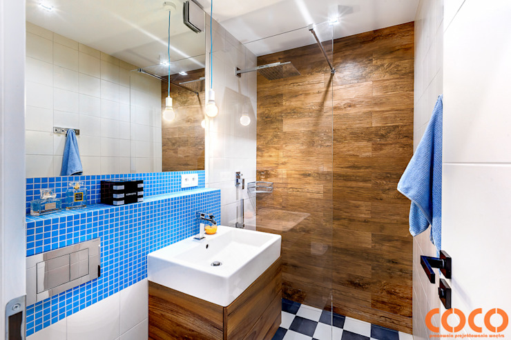 Baños de estilo moderno de COCO Pracownia projektowania wnętrz Moderno