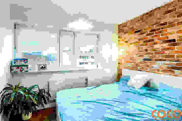 Dormitorios de estilo moderno de COCO Pracownia projektowania wnętrz Moderno