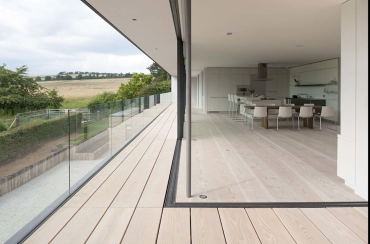 Enclosed upper terrace and living space by John Pardey Architects
