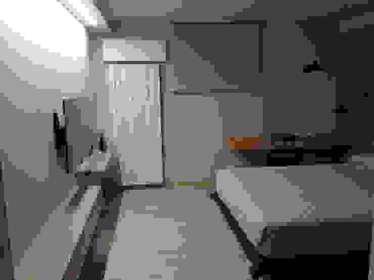 zona tv-studio Laura Canonico Architetto Camera da letto moderna