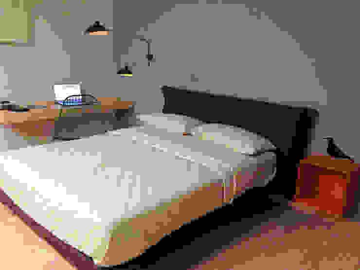 parete letto-studio Laura Canonico Architetto Camera da letto moderna