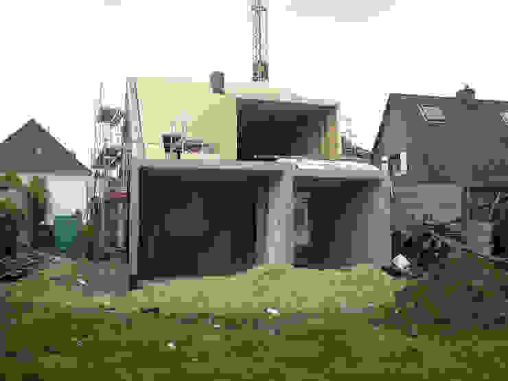 Symmetrische Deckung auf Wand und Dach Moderne Häuser von Rathscheck Schiefer und Dach-Systeme ZN der Wilh. Werhahn KG Neuss Modern