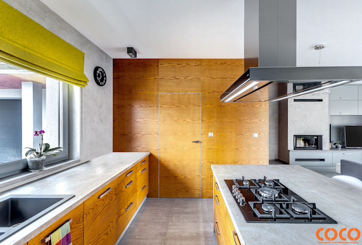 Dom w szarościach: styl , w kategorii Kuchnia zaprojektowany przez COCO Pracownia projektowania wnętrz,Minimalistyczny