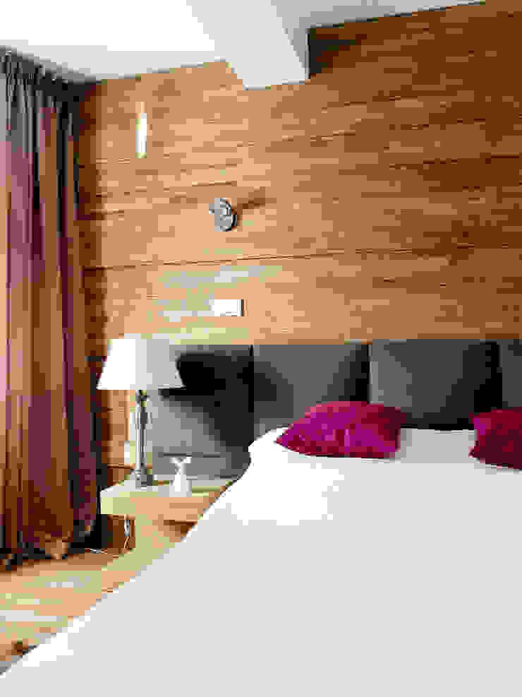 Apartament w Zakopanem - sypialnia Minimalistyczna sypialnia od Jacek Tryc-wnętrza Minimalistyczny