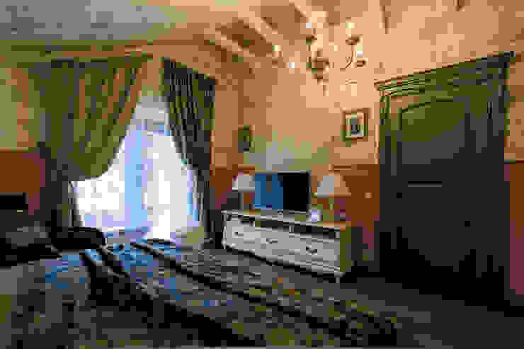 Dormitorios rurales de Студия интерьерного декора PROSTRANSTVO U Rural