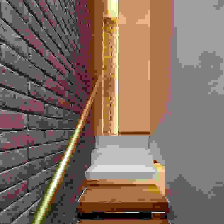 Haringey Brick House Modern corridor, hallway & stairs by Satish Jassal Architects Modern