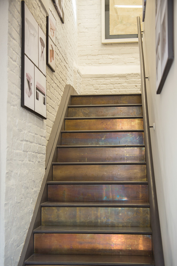Patinated Brass Cladding Industrial style corridor, hallway and stairs by Rupert Bevan Ltd Industrial