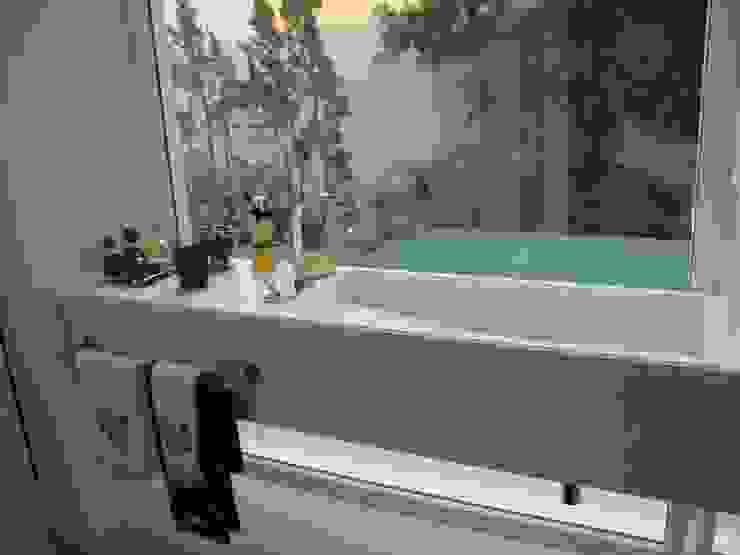 Lavabo: Banheiros  por Geraldo Brognoli Ludwich Arquitetura,