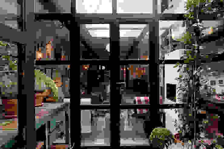 Industrial style garden by BRICKS Studio Industrial