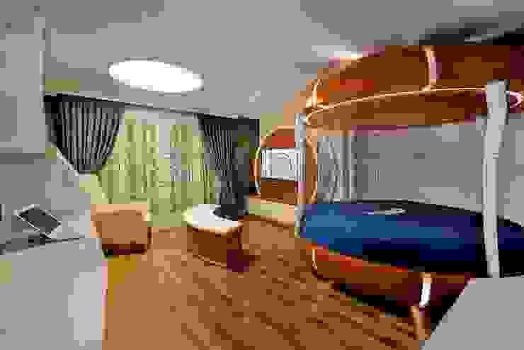 Minimalistyczny pokój dziecięcy od Akabe Mobilya San ve Tic. Ltd. Şti Minimalistyczny