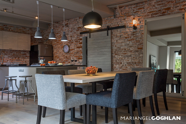 Industrial style dining room by MARIANGEL COGHLAN Industrial