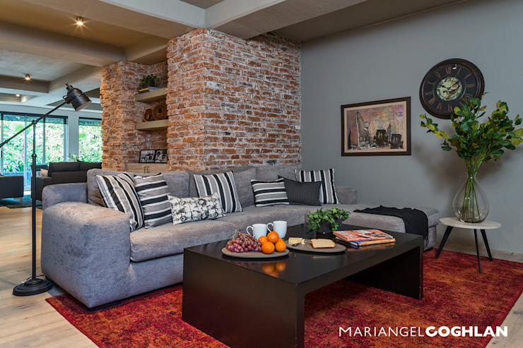 Industrial style media room by MARIANGEL COGHLAN Industrial