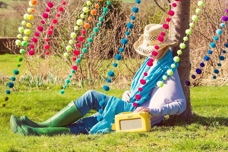 Pom Pom Garlands hanging in a tree Eclectic style garden by PomPom Galore Eclectic