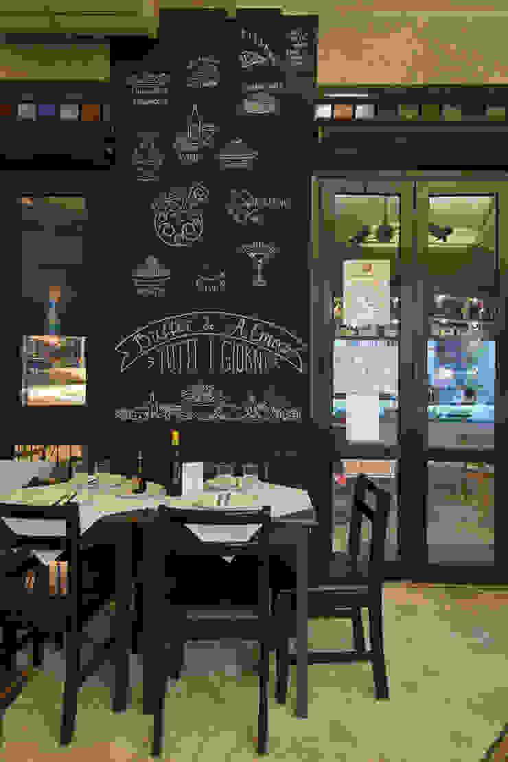 detalhe espaço interno de refeições Espaços gastronômicos ecléticos por Arquitetura Juliana Fabrizzi Eclético