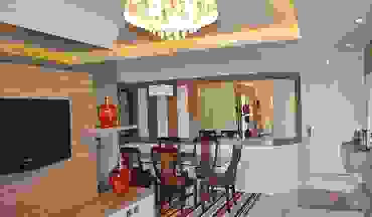 Sala estar e jantar por Ésse Arquitetura e Interiores