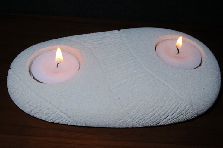 2 Tea Light holder made from Volcanic rock and cleverly carved by the artisan. Perfect for any room in the home.: eclectic  by trade.routz, Eclectic