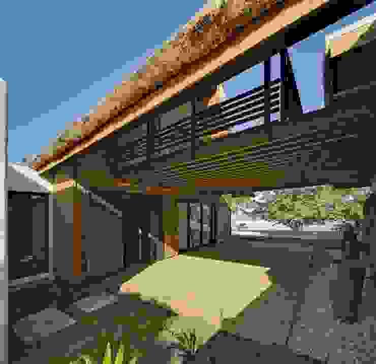 Casas de estilo tropical de T&T architecture Tropical