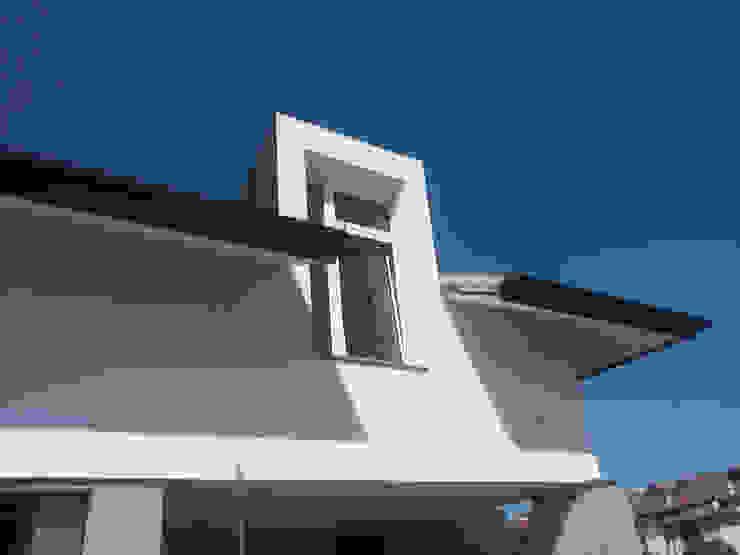 сучасний  by Andrea Martinelli Architetto, Сучасний