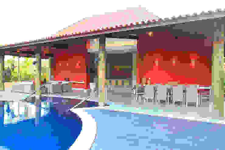 Casa Vermelha Casas campestres por Andréa Calabria Arquitetura Campestre