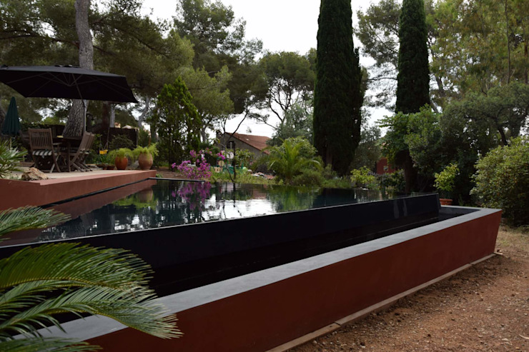 La piscine à débordement Piscine moderne par Grégory Cugnet ARCHITECTE Moderne