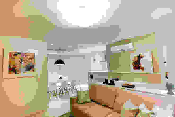 Salas de estar  por Estúdio Kza Arquitetura e Interiores