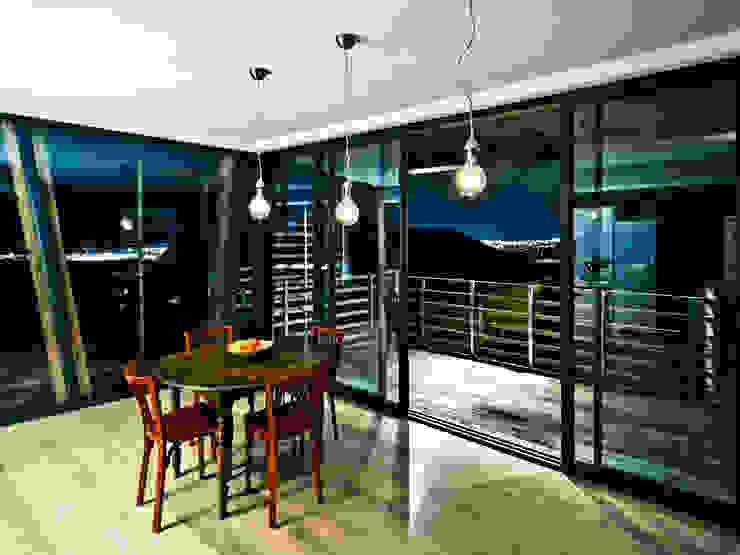 La Maison Mikado Salle à manger moderne par Hervé DELOUIS Architecte DPLG Moderne